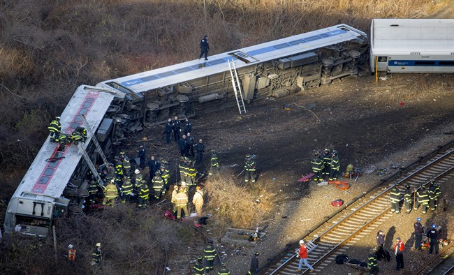 First responders gather at the derailment of a Metro-North passenger train in the Bronx borough of New York Sunday, Dec. 1, 2013.