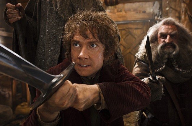 This image released by Warner Bros. Pictures shows Martin Freeman, left, and John Callen in a scene from 'The Hobbit: The Desolation of Smaug.'.