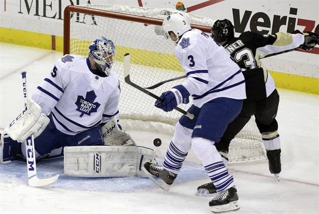 Pittsburgh Penguins right wing Chris Conner (23) gets the puck behind Toronto Maple Leafs goalie Jonathan Bernier (45) and Dion Phaneuf (3) for a goal in the first period of an NHL hockey game, Monday, Dec. 16, 2013, in Pittsburgh. (AP Photo/Gene J. Puskar).