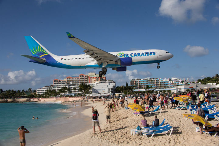 Planes approaching the Princess Juliana International Airport of Sint Maarten, constituent country of the Kingdom of the Netherlands, Caribbean.