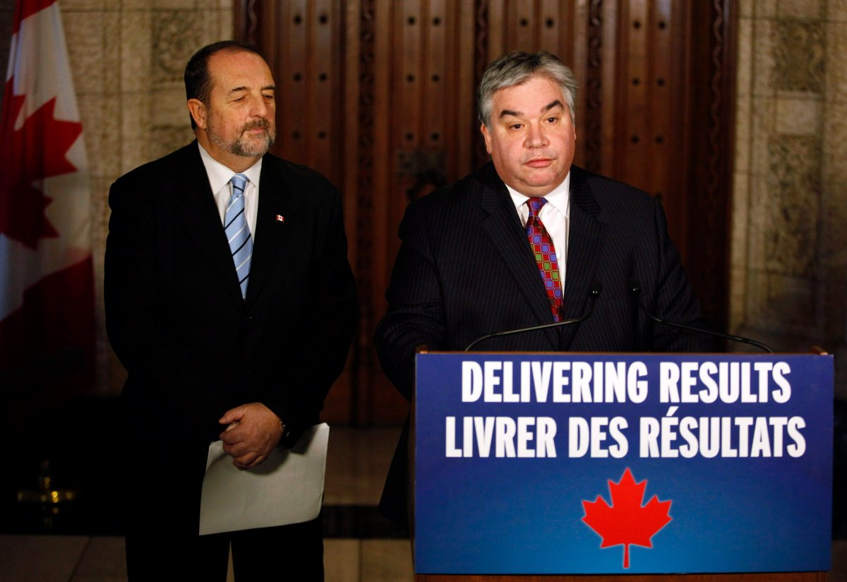 Peter Van Loan, right, Leader of the Government in the House of Commons, and the Denis Lebel, Minister of Infrastructure, make a statement on the government's legislative accomplishments on Parliament Hill in Ottawa on Thursday, December 12, 2013. THE CANADIAN PRESS/ Patrick Doyle.
