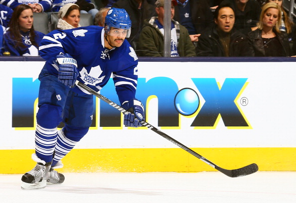 Mark Fraser #2 of the Toronto Maple Leafs skates up the ice against the Washington Capitals during NHL action at the Air Canada Centre November 23, 2013 in Toronto, Ontario, Canada.