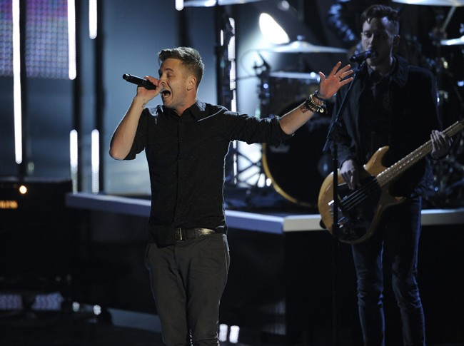 """Ryan Tedder, of the musical group OneRepublic, performs """"Counting Stars"""" on stage at the 40th annual People's Choice Awards at the Nokia Theatre L.A. Live on Wednesday, Jan. 8, 2014, in Los Angeles. (Photo by Chris Pizzello/Invision/AP)."""