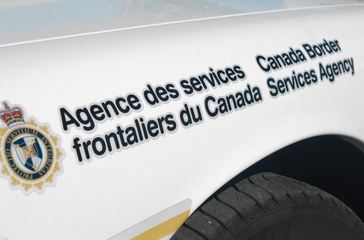 A Canada Border Services Agency (CBSA) logo on patrol car.