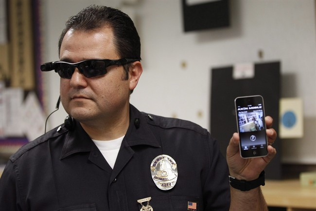Los Angeles Police Sgt. Daniel Gomez demonstrates a video feed from his camera into his cellphone as on-body cameras are demonstrated for the media.