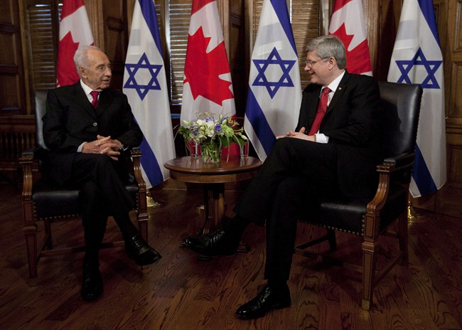 Israel President Shimon Peres talks with Canadian Canadian Prime Minister Stephen Harper before a meeting on Parliament Hill in Ottawa, Monday May 7, 2012. Harper will make history in Israel next week when he becomes the first Canadian leader to address the Israeli legislature. THE CANADIAN PRESS/Adrian Wyld.