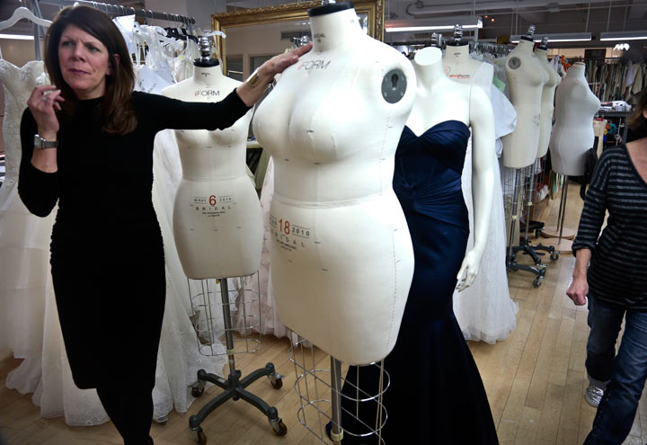 In this Dec. 17, 2013 photo, David's Bridal senior vice president Michele von Plato shows a plus-size mannequin during an interview in New York. David's Bridal, the nation's largest bridal chain, started changing its fit mannequins used to create gowns to reflect the average body.