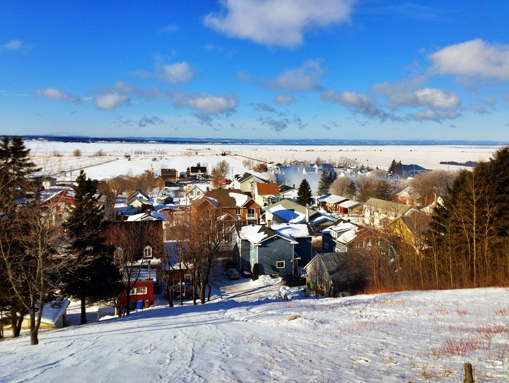 A view of the small Quebec town of L'Isle-Verte, with the still-smoking ruins of the seniors home on January 23, 2014.