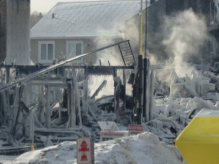 A glimpse of the still-smoking ruins of the seniors' home in L'Isle Verte, Que. on Friday, January 24, 2014.