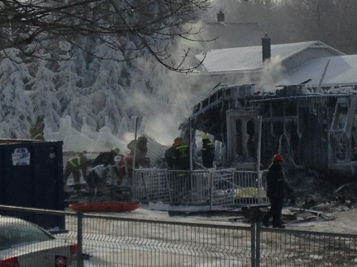 Investigators continued their grim work of sifting through the icy rubble in L'Isle Verte, Que. to try to identify more victims on Friday, January 24, 2014.