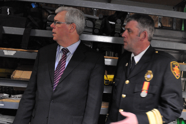 Former Manitoba Fire Commissioner Christopher Jones, right, shown with Manitoba Premier Greg Selinger in file photo.
