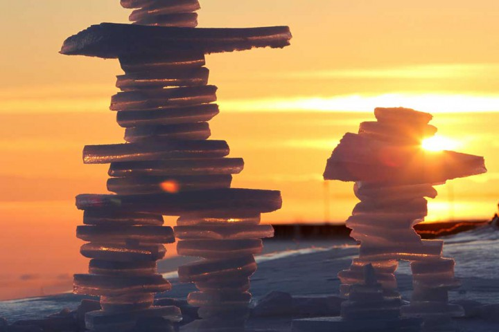Two inukshuk made out of ice stand during a winter cold snap, along the shore on Lake Ontario in Kingston, Ont., on Jan. 3, 2014.