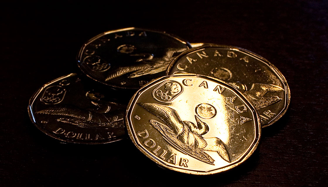 The Canadian dollar has fallen 4 per cent in January as international investors move out of the loonie and into currencies they think will hold their value or climb higher -- like the U.S. dollar.
