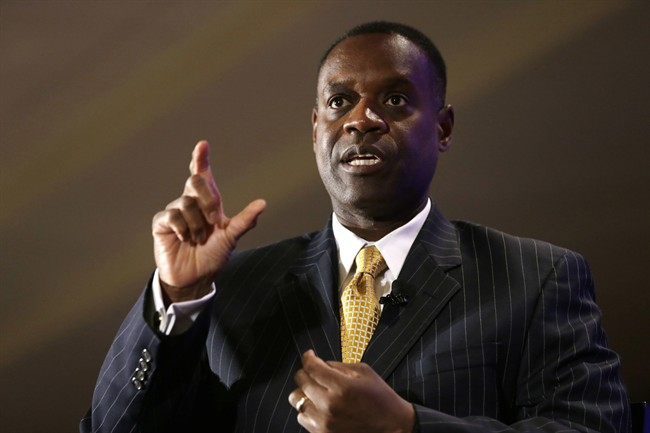 This Oct. 3, 2013, file photo shows Detroit Emergency Manager Kevyn Orr gesturing during an interview at the Detroit Economic Club luncheon in Detroit.