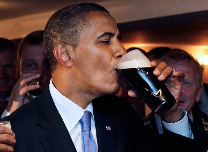 """U.S. President Barack Obama drinks Guinness beer as he meets with local residents at Ollie Hayes pub in Moneygall, Ireland. In September 2012, the White House released its own beer recipe after the online demand garnered more than 12,000 signatures and a request from a user on Reddit during Obama's """"Ask Me Anything.""""."""