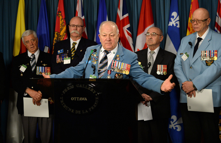 Veteran Ron Clarke joins fellow Veterans and PSAC members as they hold a news conference on Parliament Hill in Ottawa on Tuesday, January 28, 2014.