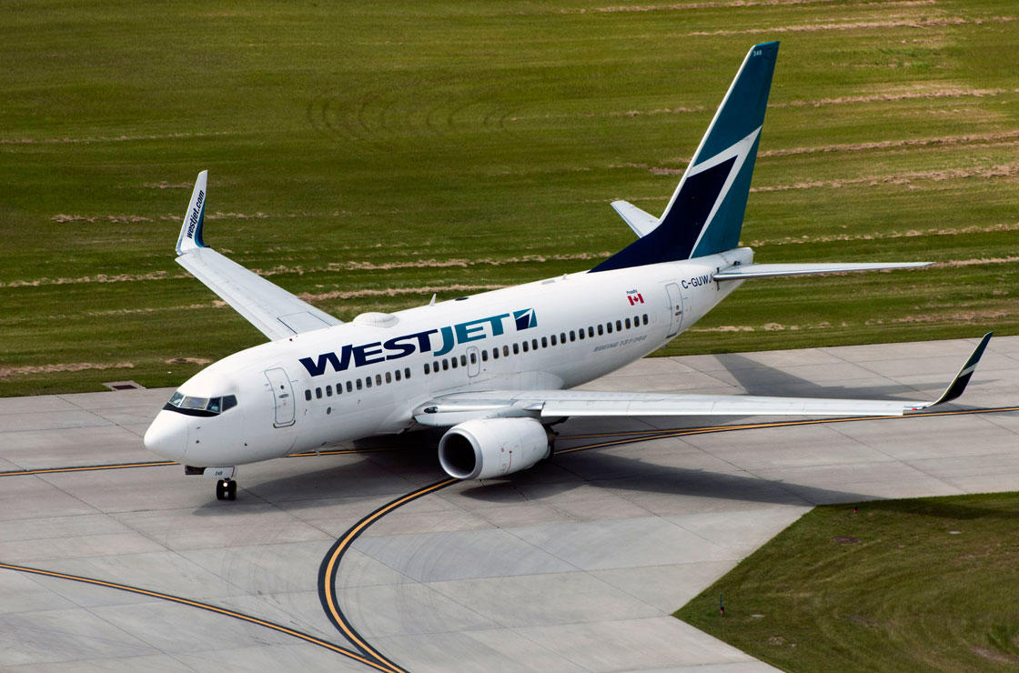 WestJet is resisting a move to adopt a new 'currency surcharge' being introduced by other operators.
