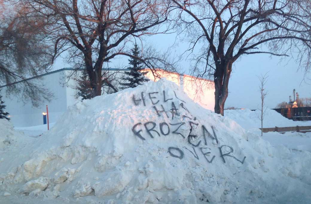 Guess someone doesn't quite see the beauty of winter. A snowbank on Archibald Street in Winnipeg.