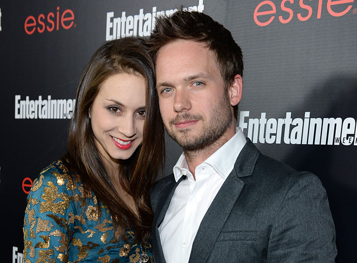 Troian Bellisario and Patrick J. Adams, pictured in January 2014.