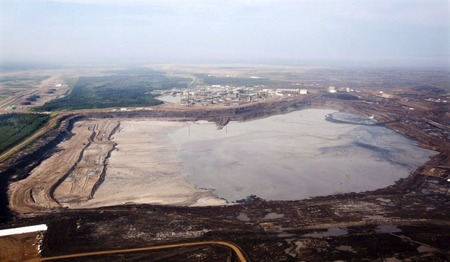 A tailings pond is picture at the Syncrude oilsands facility seen from a helicopter near Fort McMurray, Alta., July 10, 2012.