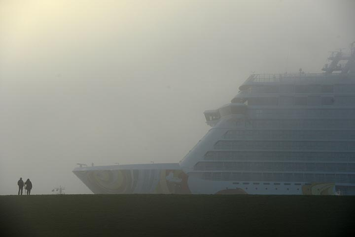 A cruise ship worker from Indonesia is accused of raping a passenger aboard a Holland America Line vessel and then trying to throw her overboard, authorities said Tuesday.