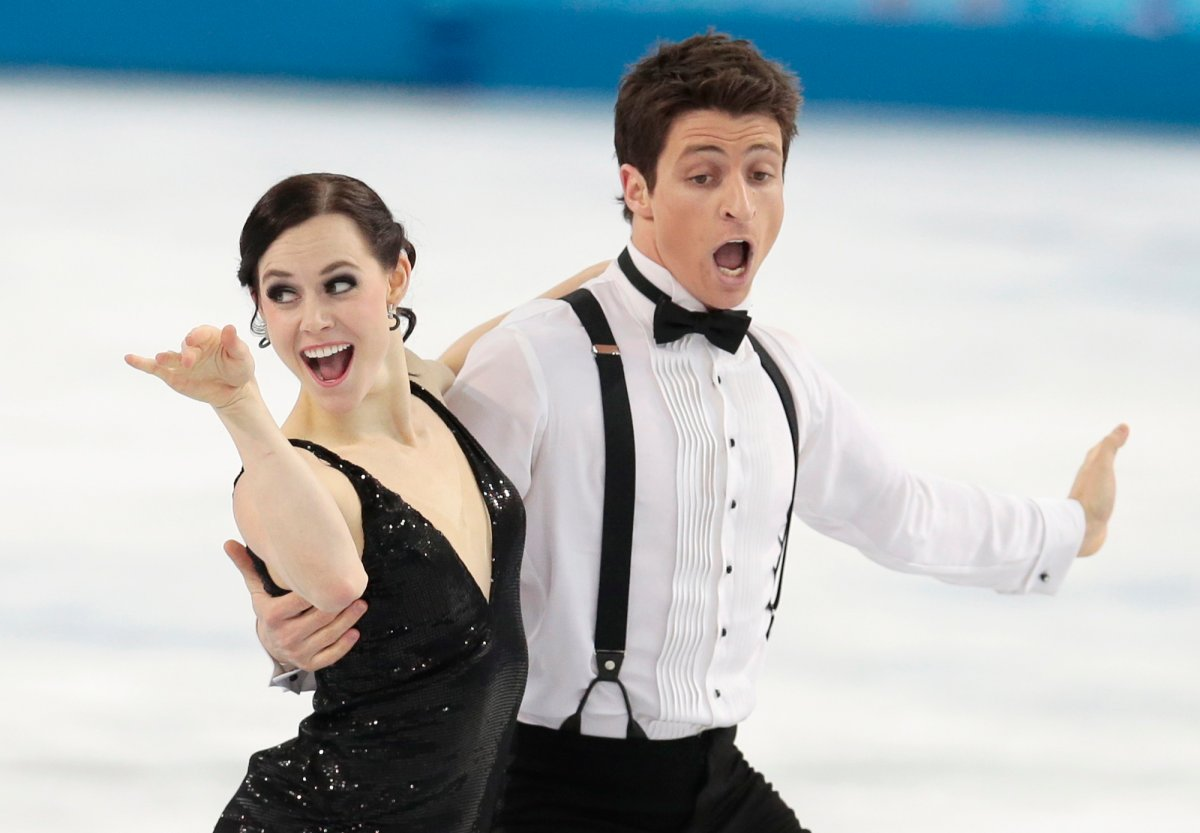 Tessa Virtue and Scott Moir of Canada compete in the team ice dance short dance figure skating competition. (Ivan Sekretarev/AP Photo).