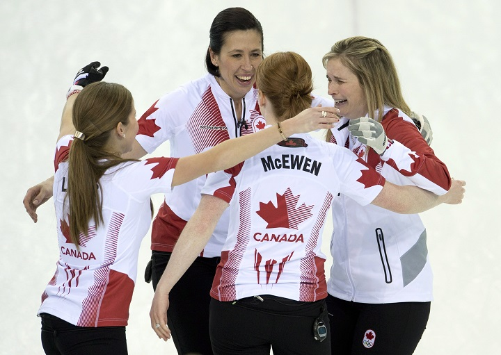 Canada skip Jennifer Jones (right) Dawn McEwen, Kaitlyn Lawes (left) and Jill Officer (back) celebrate after winning the gold medal during Olympic final curling action against Sweden at the Sochi Winter Olympics Thursday in Sochi, Russia.