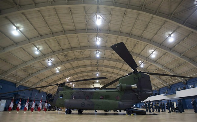 A new Chinook CH-147F helicopter sits in a hangar before an event June 27, 2013 in Ottawa.