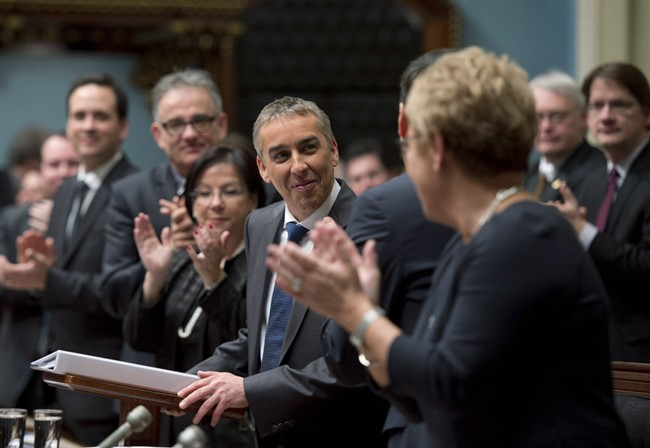 Quebec Finance Minister Nicolas Marceau is applauded by members of the government as he stands to present his budget speech, Thursday, February 20, 2014 at the legislature in Quebec City.