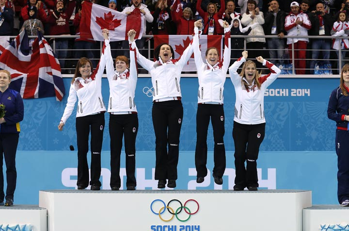 Canada's women's curling team as seen from left to right, Kirsten Wall, Dawn McEwen, Jill Officer, Kaitlyn Lawes and skip Jennifer Jones, celebrate during the flower ceremony after winning the women's curling gold medal game against Sweden at the 2014 Winter Olympics in February.