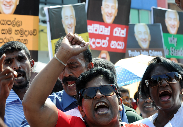 Sri Lankan Pro-government activists protest outside the US embassy in the capital Colombo on January 9, 2014. Buddhist monks led demonstrations in the capital Colombo on January 9 denouncing the visit by a US envoy who is charged with assessing allegations of war crimes against Sri Lanka.