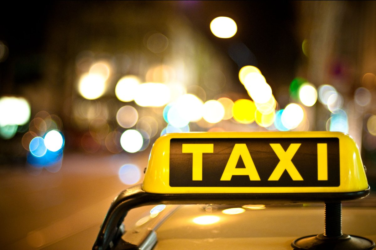 FILE: A photo of a taxi sign on top of a cab.