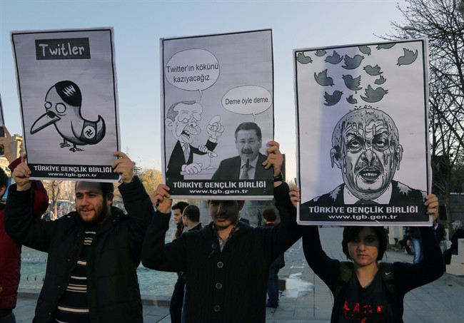 Members of the Turkish Youth Union hold cartoons depicting Turkey's Prime Minister Recep Tayyip Erdogan during a protest against a ban on Twitter, in Ankara, Turkey.