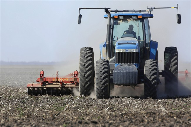 A file photo of a farmer during spring seeding.