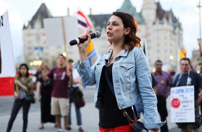 Anne-Marie Roy, president of the Student Federation of the University of Ottawa, speaks at a May Day rally in Ottawa on May 1, 2013. She is speaking out about an online conversation among five fellow students in which she was the target of sexually graphic banter. THE CANADIAN PRESS/HO-Bew Powless.