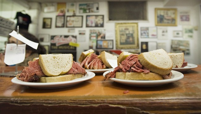 Smoked meat sandwiches sit on the counter at Schwartz's deli in Montreal, Thursday, March 8, 2012.