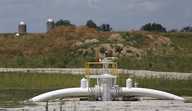 A valve extends above ground at the Enbridge Key Terminal near Salisbury, Mo., July 16, 2013.