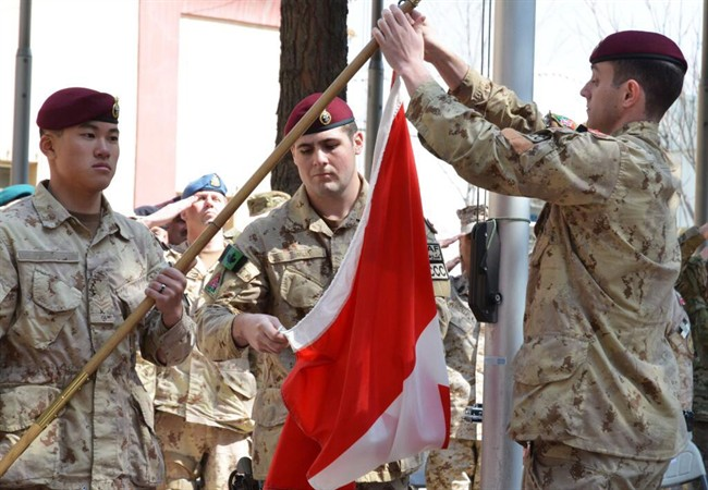 The Canadian Army hauls down the flag in Afghanistan for the last time in Kabul on Wednesday March 12, 2014.