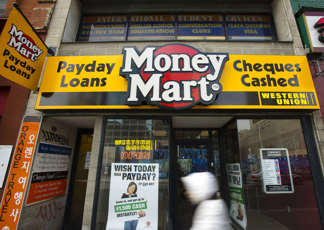 Money Mart will suspend a controversial program offering cash for gift cards at half of their face value.