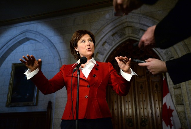 B.C. Premier Christy Clark speaks to reporters in the Foyer of the House of Commons on Parliament Hill in Ottawa on Monday, March 31, 2014. THE CANADIAN PRESS/Sean Kilpatrick.