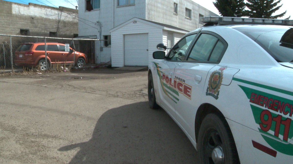 Police investigate the death of a man in Taber, Alberta, Saturday, March 15, 2014.