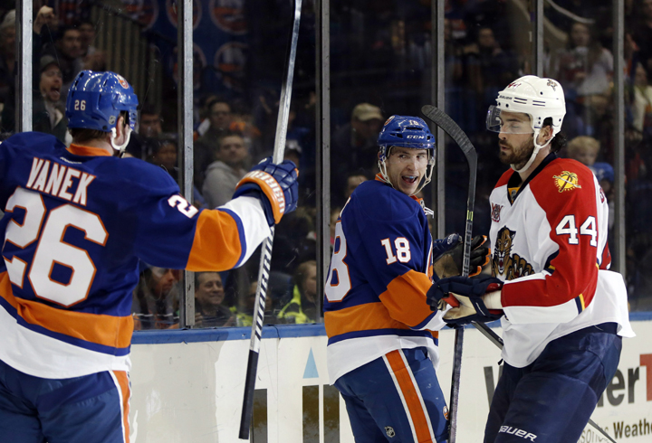 New York Islanders center Ryan Strome (18) looks back at teammate Thomas Vanek (26), of Austria, after scoring in the second period of an NHL hockey game against the Florida Panthers in Uniondale, N.Y., Sunday, March 2, 2014.