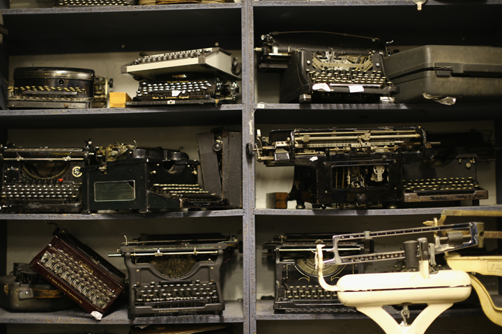 Old typewriters sit on a shelf in National Theatre's Costume and Props Hire department in Kennington on October 30, 2013 in London, England.
