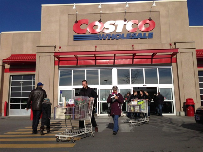 Customers walk out of Costco in Montreal on Saturday, Nov. 17, 2012.