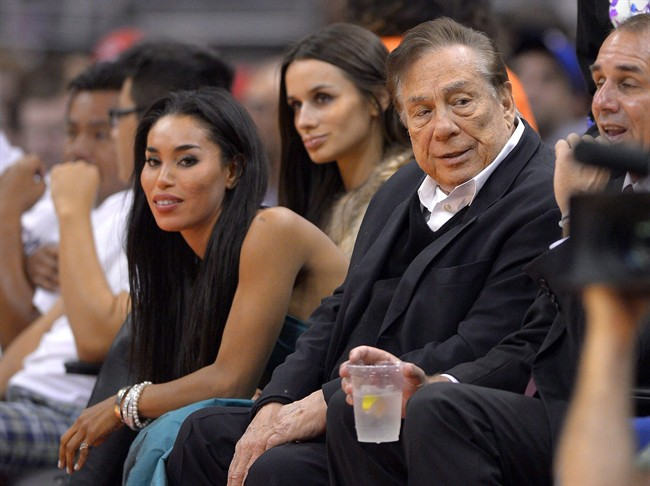 Los Angeles Clippers owner Donald Sterling, right, watches the Clippers courtside in Los Angeles on Oct. 25, 2013.