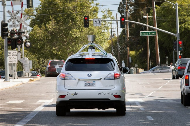 This Wednesday, April 23, 2014 photo provided by Google shows the Google driverless car navigating along a street in Mountain View, Calif.