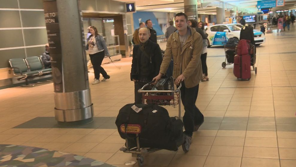 James Birkbeck (accompanied by his cousin on the left) getting ready to head back to the U.K. Wednesday afternoon.