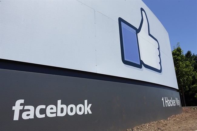 This Tuesday, July 16, 2013 file photo shows a sign at Facebook headquarters in Menlo Park, Calif. Facebook reports quarterly earnings on Wednesday, April 23, 2014.