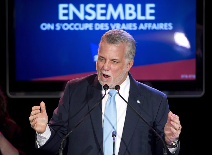 Quebec Liberal Leader Philippe Couillard speaks to supporters in his victory speech, Monday, April 7, 2014 in St-Felicien, Que.