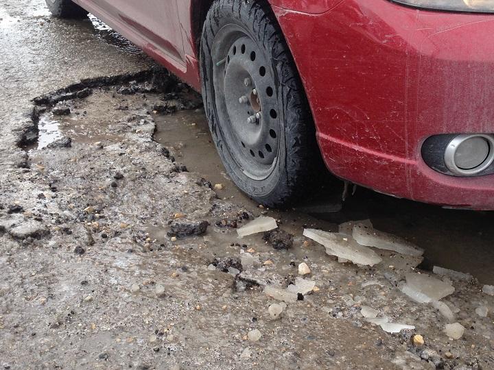 Winnipeg pothole pot hole streets asphalt roads CAA MPI